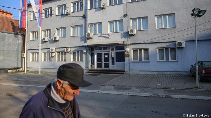 A man walks by a Serb municipal building in North Mitrovica Photo: Bojan Slavkovic