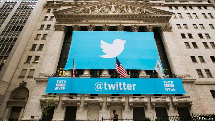 A sign displays the Twitter logo on the front of the New York Stock Exchange ahead of the company's IPO in New York, November 7, 2013. Twitter Inc could face volatile trade in its debut Thursday on the New York Stock Exchange, analysts said, but they remained enthusiastic after the money-losing social media company priced its IPO above the expected range. The microblogging network priced 70 million shares at $26 on Wednesday evening, above the targeted range of $23 to $25, which had been raised once before. The IPO values Twitter at $14.1 billion (8.8 billion pounds), with the potential to reach $14.4 billion if underwriters exercise an over-allotment option. REUTERS/Lucas Jackson (UNITED STATES - Tags: BUSINESS SCIENCE TECHNOLOGY)