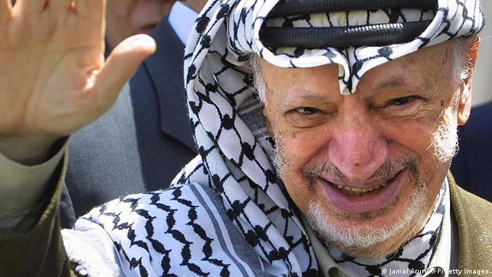 Palestinian President Yasser Arafat greets photographers after his meeting with the Egyptian intellegence chief Omar Suleiman at Arafat's headquarters in the West Bank city of Ramalla following their meeting in Ramalla 11 June 2003 . Suleiman is involved in a bid to broker a truce between radical Palestinian militants and Israel. AFP PHOTO/Jamal ARURI (Photo credit should read JAMAL ARURI/AFP/Getty Images)