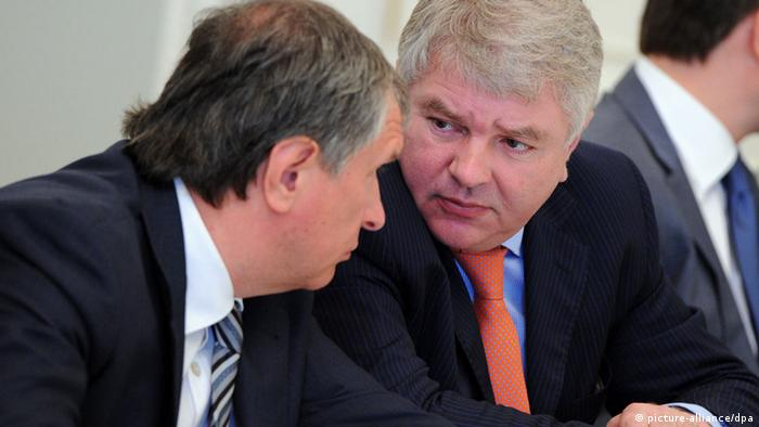 Rosneft President Igor Sechin, left, and Deputy Foreign Minister Alexei Meshkov before a meeting on cross subsidies in the power industry at Bocharov Ruchei residence in Sochi. Michael Klimentyev/RIA Novosti