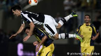 Srdjan Lakic of Eintracht Frankfurt vies for the ball with Nikola Mitrovic (Photo: EPA/OLIVER WEIKEN)