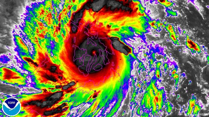 A brightly colored satellite image of Typhoon Haiyan