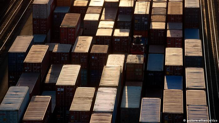 Many shipping containers sit on top of one another
