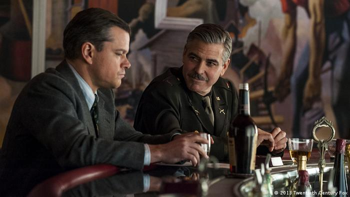 Chatting at a bar, Matt Damon and George Clooney play Monuments Men in the upcoming film. Photo: 2013 Twentieth Century Fox