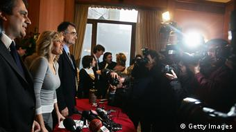 Alessandra Mussolini (C) head of the extreme-right party A.S. (Social Action) and granddaughter of former Italian dictator Benito Mussolini, Roberto Fiore, leader of Forza Nuova and Adriano Tilghe, leader of Fronte Sociale Nazionale pose for photographers during a press conference in Rome.