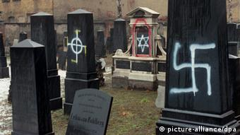 Swastika smeared on a gravestone at a Jewish cemetery in Leipzig