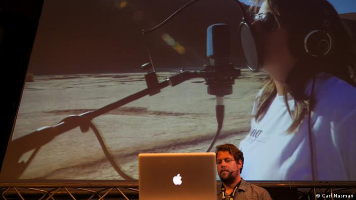 At the conference: a video of Juliet Harding recording her vocals in the desert (Photo: Carl Nasman)