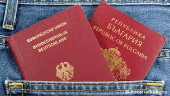 Two maroon-colored passports lie atop each other.