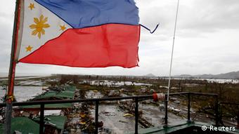 A Philippine flag flutters atop the control tower of a damaged airport after super Typhoon Haiyan battered Tacloban city, central Philippines, November 9, 2013. (Photo: REUTERS/Romeo Ranoco)