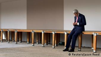U.S. Secretary of State John Kerry checks his Blackberry before a meeting with European Union foreign policy chief Catherine Ashton and Iranian Foreign Minister Mohammad Javad Zarif in Geneva, November 9, 2013. REUTERS/Jason Reed (SWITZERLAND - Tags: POLITICS)