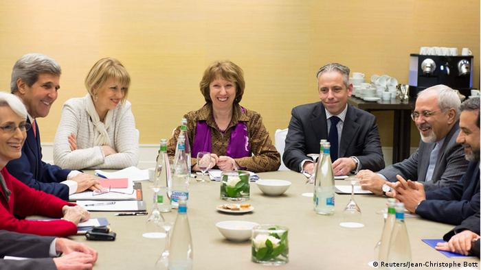 U.S. Secretary of State John Kerry (2nd L), EU foreign policy chief Catherine Ashton (C), and Iranian Foreign Minister Mohammad Javad Zarif (2nd R) attend the third day of closed-door nuclear talks at the Intercontinental Hotel in Geneva November 9, 2013. France warned of serious stumbling blocks to a long-sought deal on Iran's nuclear programme as foreign ministers from Tehran and six world powers extended high-stakes negotiations into a third day on Saturday to end a decade-old standoff. REUTERS/Jean-Christophe Bott/Pool (SWITZERLAND - Tags: POLITICS ENERGY)