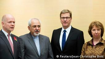 (L-R) British Foreign Secretary William Hague, Iranian Foreign Minister Mohammad Javad Zarif, Germany's Foreign Minister Guido Westerwelle and EU foreign policy chief Catherine Ashton attend the third day of closed-door nuclear talks at the Intercontinental Hotel in Geneva November 9, 2013. France warned of serious stumbling blocks to a long-sought deal on Iran's nuclear programme as foreign ministers from Tehran and six world powers extended high-stakes negotiations into a third day on Saturday to end a decade-old standoff. REUTERS/Jean-Christophe Bott/Pool (SWITZERLAND - Tags: POLITICS ENERGY)