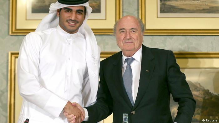 FIFA President Sepp Blatter (R) shakes hands with Qatar's 2022 World Cup Bid Chief Sheikh Mohammed Al-Thani (L) at a news conference in Doha November 9, 2013. Blatter confirmed that the 2022 World Cup will be moved to the end of the year. He also denied that Qatar will share hosting the World Cup with other countries in the region. REUTERS/Fadi Al-Assaad
