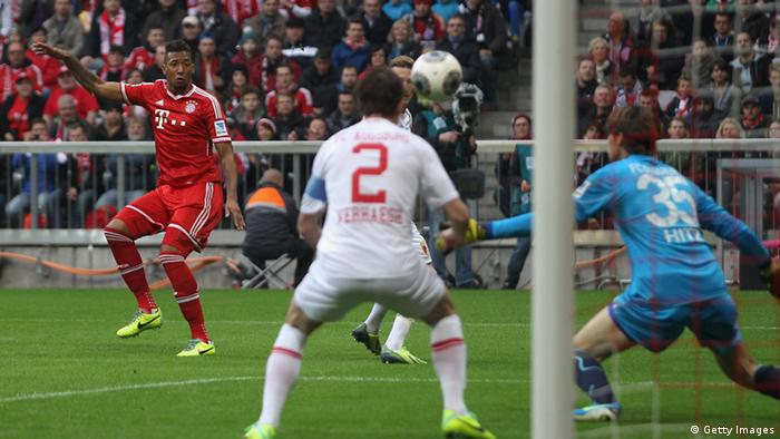MUNICH, GERMANY - NOVEMBER 09: Jerome Boateng (L) of Bayern Muenchen fscores his first goal against Paul Verhaegh (C) and goalkeeper Marvin Hitz of Augsburg during the Bundesliga match between FC Bayern Muenchen and FC Augsburg at Allianz Arena on November 9, 2013 in Munich, Germany. (Photo by Alexandra Beier/Bongarts/Getty Images)