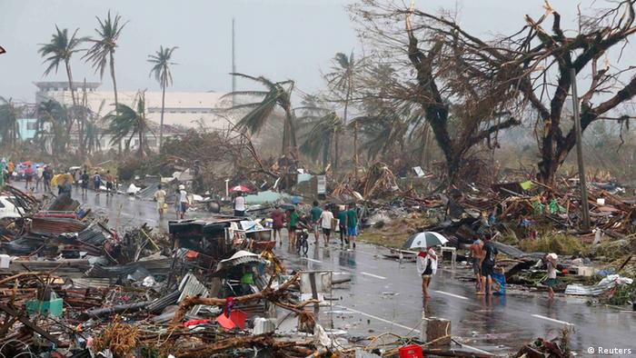 Residents walk on a road littered with debris after Super Typhoon Haiyan battered Tacloban city in central Philippines November 10, 2013.(Photo: Reuters)