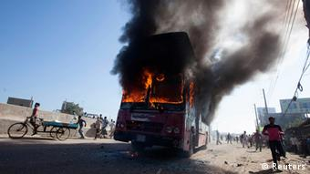 Smoke rises as a bus burns on a street after a nationwide strike was called, in Dhaka November 9, 2013. (Photo: Reuters)