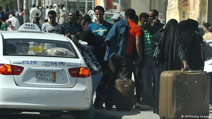 Foreign workers wait for a taxi as they leave the Manfuhah neighbourhood of the Saudi capital Riyadh on November 10, 2013, after two people have been killed in clashes between Saudi and other foreign residents the previous day, according to the Saudi police. On November 4, the authorities began rounding up thousands of illegal foreign workers following the expiry of a final amnesty for them to formalise their status. AFP PHOTO/FAYEZ NURELDINE (Photo credit should read FAYEZ NURELDINE/AFP/Getty Images)