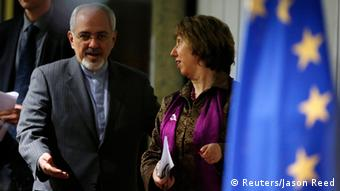 European Union foreign policy chief Catherine Ashton (R) and Iranian Foreign Minister Mohammad Javad Zarif arrive at a news conference at the end of the Iranian nuclear talks in Geneva November 10, 2013. REUTERS/Jason Reed (SWITZERLAND - Tags: POLITICS TPX IMAGES OF THE DAY)