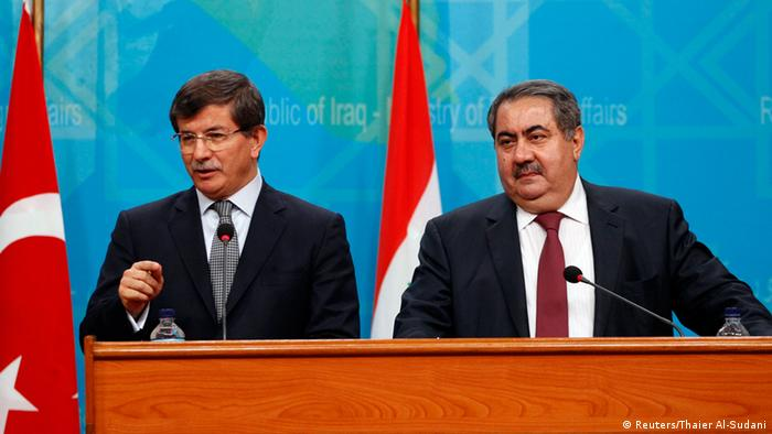 Turkish Foreign Minister Ahmet Davutoglu addresses the media during a joint news conference with Iraq's Foreign Minister Hoshiyar Zebari (R) at the Foreign Ministry headquarters in Baghdad, November 10, 2013. REUTERS/Thaier Al-Sudani (IRAQ - Tags: POLITICS)