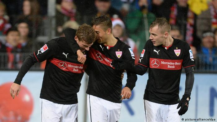Timo Werner, Moritz Leitner and Alexandru Maxim (l-r) celebrate