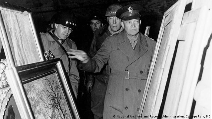 A black and white photo from 1945 with Lt. Gen. Omar N. Bradley, Lt. Gen. George S. Patton Jr., and Gen. Dwight D. Eisenhower as they inspect the German museum treasures stored in the Merkers mine. Photo: Walker Hancock Collection