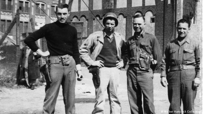 A black and white photo shot in May 1945 with Monuments Men George Stout (left), Walker Hancock (center right), and Steven Kovalyak (right) during the excavation of Bernterode. The soldier standing between Stout and Hancock is a Sgt. Travese. Photo: Walker Hancock Collection