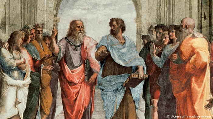 افلاطون و ارسطو، نقاشی دیواری اثر رافائل. در حالیکه افلاطون با انگشت آسمان را نشان میدهدارسطو با دست به زمین اشاره میکند