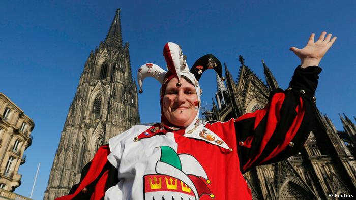 A carnival reveller celebrates the start of the carnival in Cologne November 11, 2013. In many parts of Germany, at 11:11am on November 11, REUTERS/Ina Fassbender
