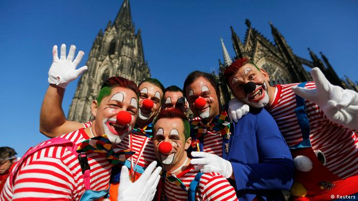 Carnival revellers celebrate the start of the carnival in Cologne November 11, 2013. In many parts of Germany, at 11:11am on November 11, people mark the official start of Carnival, a season of controlled raucous fun that reaches a climax during the days before Ash Wednesday and the start of Lent. REUTERS/Ina Fassbender