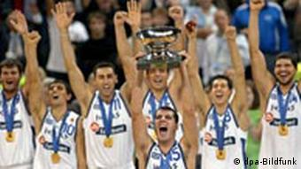Greek national team captain Michail Kakiouzis (C) lifts the winner's trophy after their victory in the final match of the Men's European basketball Championships against Germany in Belgrade, Sunday 25 September 2005