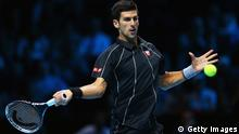 LONDON, ENGLAND - NOVEMBER 11: Novak Djokovic of Serbia hits a forehand in his men's singles final match against Rafael Nadal of Spain during day eight of the Barclays ATP World Tour Finals at O2 Arena on November 11, 2013 in London, England. (Photo by Clive Brunskill/Getty Images)