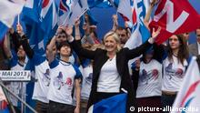 epa03683715 French National Front political party leader, Marine Le Pen, attends the party's traditional May Day rally in Paris, France, 01 May 2013. EPA/IAN LANGSDON