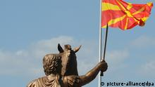 Alexander the Great statue with Macedonian flag