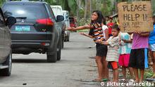 Philippinen Haiyan Kinder betteln (picture-alliance/dpa)