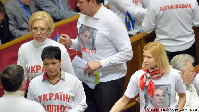 Ukrainian opposition deputies wear on November 8, 2013 T-shirts, bearing a picture of Yulia Tymoshenko or the slogans 'Free Yulia' and 'Free Ukraine,' (Photo: SERGEI SUPINSKY/AFP/Getty Images)