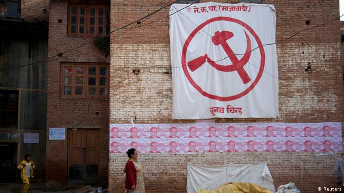 A woman walks past the election campaign posters of Unified Communist Party of Nepal (Maoist), during the election campaign of their party chairman Pushpa Kamal Dahal, also known as Prachanda, at Kritipur in Kathmandu October 29, 2013. (Photo: REUTERS/Bikash Karki)