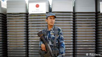 A member of Nepal's Armed Police Force (APF) stands guard in front of the ballot boxes kept at Election Commission (EC) premises, waiting to be distributed nation-wide, in Kathmandu October 23, 2013. (Photo: REUTERS/Navesh Chitrakar)