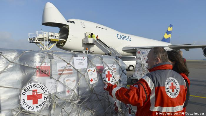 Helpers load aid packages on a cargo aircraft ODD ANDERSEN/AFP/Getty Images)