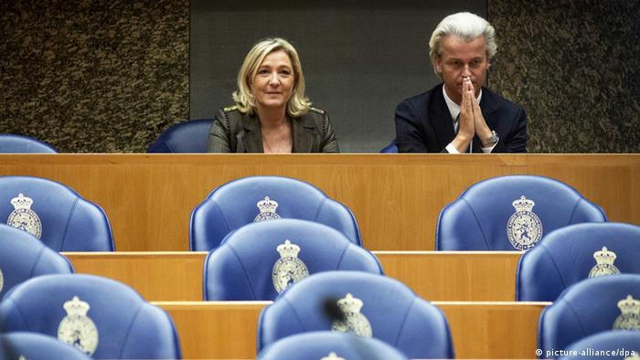 epa03947953 Dutch leader of the Party for Freedom (PVV) Geert Wilders (R) and Marine Le Pen (L), leader of the French National Front (FN), during a debate in the Senate in The Hague, The Netherlands, 13 November 2013. Le Pen and Wilders were to discuss the formation of a joint political campaign ahead of next year's European elections. EPA/VALERIE KUYPERS
