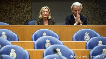 Marine Le Pen and Geert Wilders seated next to each other during a debate in the senate in The Hague (Photo: EPA/VALERIE KUYPERS)