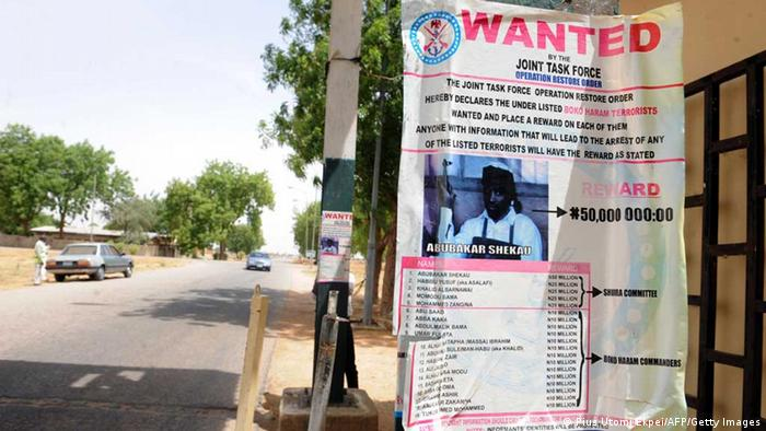 A poster displayed along the road shows photograph of Imam Abubakar Shekau, leader of the militant Islamist group Boko Haram, declared wanted by the Nigerian military with $320,471 reward for information that could lead to his capture in northeastern Nigeria town of Maiduguri May 1, 2013. PIUS UTOMI EKPEI/AFP/Getty Images