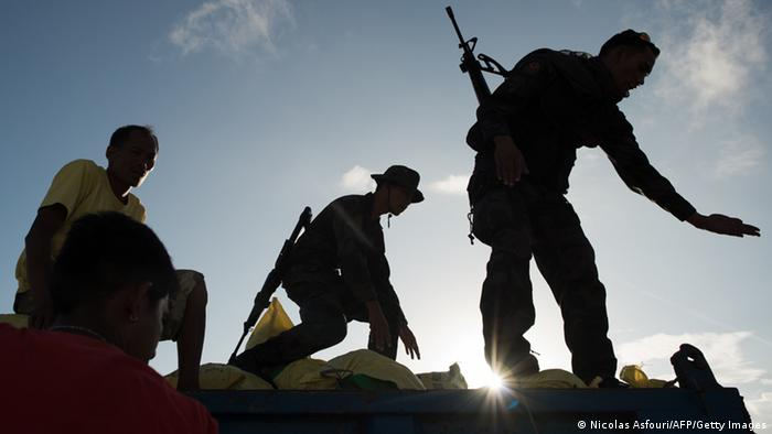 GettyImages 187922751 Philippines army soldiers and workers load an army truck with bags of rice to be distributed to typhoon survivors, at Tacloban airport on November 14, 2013. The United Nations estimates 10,000 people may have died in Tacloban alone, where five-metre (16-foot) waves flattened nearly everything in their path as they swept hundreds of metres across the low-lying land. AFP PHOTO / Nicolas ASFOURI (Photo credit should read NICOLAS ASFOURI/AFP/Getty Images)