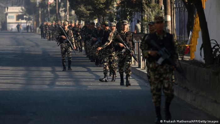 Nepalese army soldiers patrol during a general strike, called by the 33-party alliance and led by the Communist Party of Nepal-Maoist, in Kathmandu on November 11, 2013. (Photo: AFP)