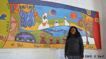 Elizabeth Suárez in front of a mural about Afro-Uruguayan history (photo: Eilis O'Neill)