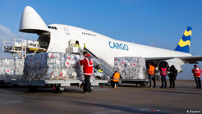 A staff member of the German Red Cross checks a relief cargo pallet before it is loaded into a plane bound for the Philippines at Schoenefeld Airport outside Berlin, November 13, 2013. An aid delivery funded by the German Red Cross, the Federal Agency for Technical Relief (THW) and the German Ministry of Foreign Affairs left by plane on Wednesday for the Philippine island of Cebu to deliver relief to Typhoon Haiyan survivors. Desperation gripped Philippine islands devastated by Typhoon Haiyan as looting turned deadly and survivors panicked over delays in supplies of food, water and medicine. REUTERS/Thomas Peter (GERMANY - Tags: DISASTER)