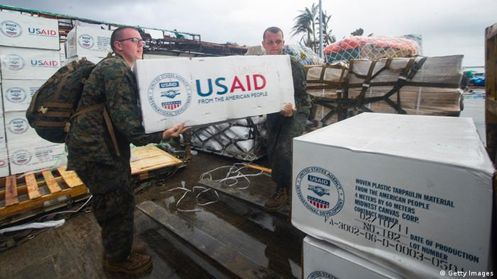 TACLOBAN, PHILLIPINES - NOVEMBER 14: In this handout provided by the U.S. Navy, hospital Corpsman 3rd Class Eric Chiarito (L) of Hyde Park, N.Y., and Marine Sgt. Jonathan Thornton, of Lake Havasu, Arizonia, load supplies onto a forklift at Tacloban Air Base in support of Operation Damayan November 14, 2013 in Tacloban, the Phillipines. The George Washington Carrier Strike Group and the 3rd Marine Expeditionary Brigade are assisting the Philippine government in response to the aftermath of Typhoon Haiyan (Yolanda). (Photo by Ricardo R. Guzman/U.S. Navy via Getty Images)