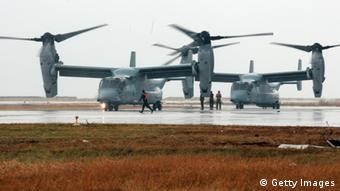 TACLOBAN, PHILIPPINES - NOVEMBER 14: US Bell Boeing V-22 Osprey arrive at the airport to transport humanitarian workers to typhoon affected areas on November 14, 2013 in Tacloban, Leyte, Philippines to help people affected by typhoon. Typhoon Haiyan which ripped through Philippines over the weekend has been described as one of the most powerful typhoons ever to hit land, leaving thousands dead and hundreds of thousands homeless. Countries all over the world have pledged relief aid to help support those affected by the typhoon, however damage to the airport and roads have made moving the aid into the most affected areas very difficult. With dead bodies left out in the open air and very limited food, water and shelter, health concerns are growing. (Photo by Jeoffrey Maitem/Getty Images)