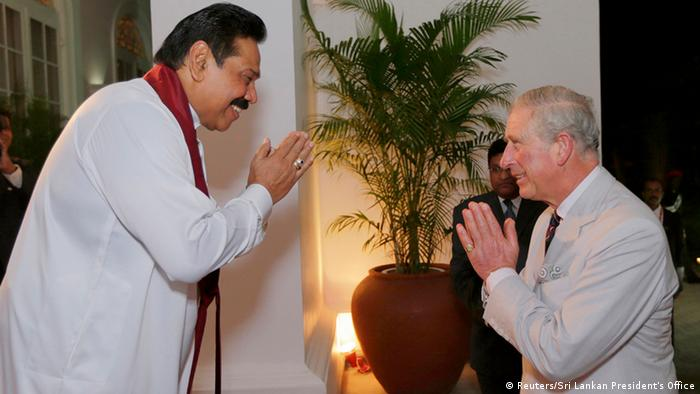 Britain's Prince Charles is welcomed by Sri Lanka's President Mahinda Rajapaksa at the presidential house in Colombo in this November 14, 2013 picture provided by the Sri Lankan President's Office. Prince Charles is in Colombo to participate in the Commonwealth Heads of Government Meeting (CHOGM). REUTERS/Sri Lankan President's Office/Handout via Reuters (SRI LANKA - Tags: POLITICS ROYALS ENTERTAINMENT) ATTENTION EDITORS - THIS IMAGE WAS PROVIDED BY A THIRD PARTY. FOR EDITORIAL USE ONLY. NOT FOR SALE FOR MARKETING OR ADVERTISING CAMPAIGNS. THIS PICTURE IS DISTRIBUTED EXACTLY AS RECEIVED BY REUTERS, AS A SERVICE TO CLIENTS. NO SALES. NO ARCHIVES