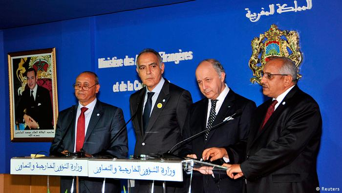 (L-R) Foreign Ministers Mohammed Abdelaziz of Libya, Salaheddine Mezouar of Morocco, Laurent Fabius of France and Zahabi Ould Sidi Mohamed of Mali attend a news conference during the regional conference on border security in Rabat November 14, 2013. Foreign ministers from across the Sahel and Maghreb gather at the conference to look for ways to boost border security. REUTERS/Stringer (MOROCCO - Tags: POLITICS)