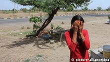 FILE - epa03473125 YEARENDER 2012 FEATURE PACKAGES A young sex worker from Banchhara community hides her identity as she stands on the Neemuch Mandsaur highway in rural Madhya Pradesh, India, 15 May 2012. Mainly these sex workers operate from the Mandsaur highway. The women negotiate with drivers and are driven off in trucks or stay with drivers in their makeshifts houses locally known as Dera. EPA/HARISH TYAGI PLEASE REFER TO ADVISORY NOTICE (zu dpa «Haussklaven, Sexarbeiter, Bettler - Indiens vermisste Kinder» vom 24.05.2013) +++(c) dpa - Bildfunk+++
